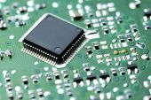 foto of microprocessor  - Closeup of a chip in an integrated circuit - JPG