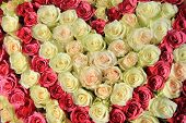 picture of centerpiece  - Roses in different shades of pink in a big wedding centerpiece