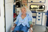 picture of ambulance car  - Injured senior man sitting on stretcher in ambulance car - JPG