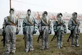 image of doomsday  - A group of soldiers with guns in their masks and protective clothing - JPG