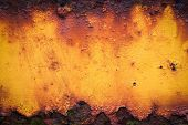 stock photo of oxidation  - Close Up of old yellow rusty metal grunge background - JPG