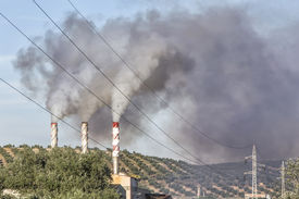 stock photo of gases  - Chimney expelling pollutant gases to the air Spain - JPG