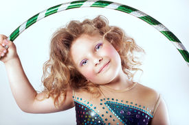foto of hulahoop  - Portrait of pretty little girl with hulahoop looking at camera - JPG