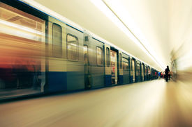 stock photo of commutator  - Motion blurred commuters walking in subway station - JPG