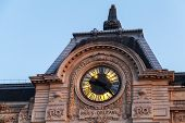 pic of gare  - Evening illumination of famous ancient clock on the wall of Orsay Museum in Paris - JPG