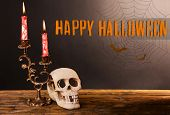 picture of bloody  - Bloody candles for Halloween holiday and decorative skull on pumpkin - JPG