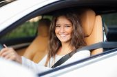 picture of luxury cars  - Young woman driving her car - JPG