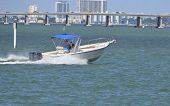 stock photo of outboard engine  - Sport fishing boat cruising on biscayne bay in Miami Beach - JPG
