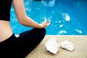 picture of padmasana  - Yoga Meditation hand by pool lotus pose  - JPG