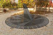 pic of sundial  - Sun clock marble sundial in Kiev Kyiv Ukraine photo - JPG