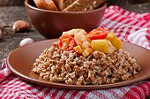 stock photo of porridge  - Buckwheat porridge with chicken and vegetables on plate - JPG