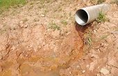 image of wastewater  - Plastic sewer pipe drain the water from the hill - JPG