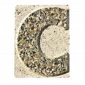 stock photo of carving  - Letter C carved in a concrete block  - JPG