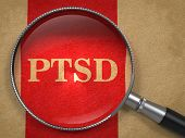 picture of lined-paper  - PTSD through Magnifying Glass on Old Paper with Red Vertical Line - JPG