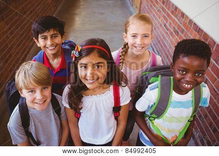Portrait of grinning little school kids in school passage