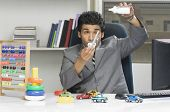 stock photo of imbecile  - Businessman behaving like a kid in an office - JPG