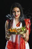foto of pooja  - Beautiful woman in a Bengali sari holding pooja thali - JPG