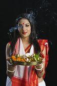 stock photo of pooja  - Beautiful woman in a Bengali sari holding pooja thali - JPG