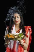 picture of pooja  - Beautiful woman in a Bengali sari holding pooja thali - JPG