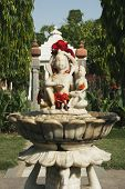stock photo of lakshmi  - Statues in the garden of a temple - JPG