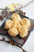 image of baklava  - Eastern dessert baklava honey with nuts on a plate - JPG