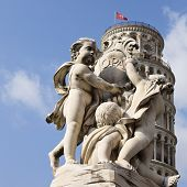 picture of putty  - Statue in front of a tower - JPG
