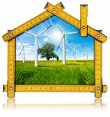 image of electricity meter  - Wooden yellow meter tool forming a ecologic house with wind energy turbine power station inside - JPG