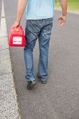 stock photo of petrol  - Man bringing petrol canister to a broken down car in the street - JPG
