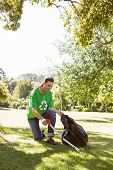 picture of pick up  - Environmental activist picking up trash on a sunny day - JPG