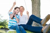 pic of swing  - Happy blonde swing with her daughter on a sunny day - JPG