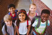image of little kids  - Portrait of smiling little school kids in school corridor - JPG