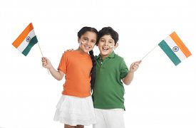 stock photo of indian flag  - Children holding Indian flags - JPG