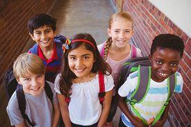 picture of child development  - Portrait of smiling little school kids in school corridor - JPG