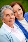 pic of elderly woman  - Portrait of an elder mother and daughter smiling outdoors - JPG