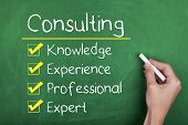 stock photo of experiments  - Consulting concept with knowledge experience professional expert words on chalkboard - JPG