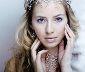 foto of snow queen  - beauty young snow queen in fairy flashes with hair crown on her head close up - JPG
