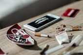 stock photo of crack cocaine  - Close up on cigarette and lines of cocaine - JPG