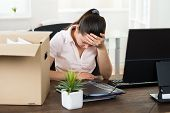 picture of upset  - Young Upset Businesswoman Sitting At Desk In Office - JPG