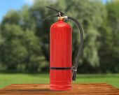 image of fire extinguishers  - New blank red fire extinguisher in closeup - JPG