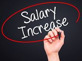 picture of employee month  - Man Hand writing Salary Increase with black marker on visual screen - JPG