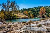 foto of crystal clear  - Fall Foliage On An Unknown Crystal Clear Creek In The Rugged Hill Country Of Texas - JPG