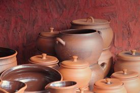 stock photo of loamy  - Different kinds of ceramics pots for sale taken closeup - JPG