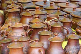 image of loamy  - Plenty of ceramics pots for sale taken closeup - JPG
