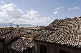picture of inverted  - The typical inverted roof tiles of the old city of Segovia Spain - JPG