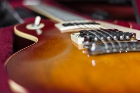 stock photo of extreme close-up  - Extreme close-up of an electric guitar in its carry case. ** Note: Shallow depth of field - JPG