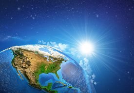 image of landforms  - Rising sun over the Earth and its landforms view of the United States of America - JPG