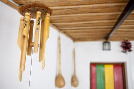 foto of reggae  - Hanging bamboo wind chimes and reggae color wooden door at the bottom - JPG