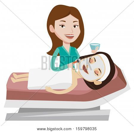 poster of Cosmetologist applying cosmetic mask on face of client in beauty salon. Young woman lying on table i
