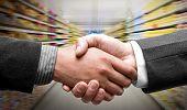 stock photo of grocery store  - Handshake at supermarket - JPG