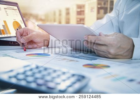 poster of Businessman Is Deeply Reviewing A Financial Report For A Return On Investment Or Investment Risk Ana